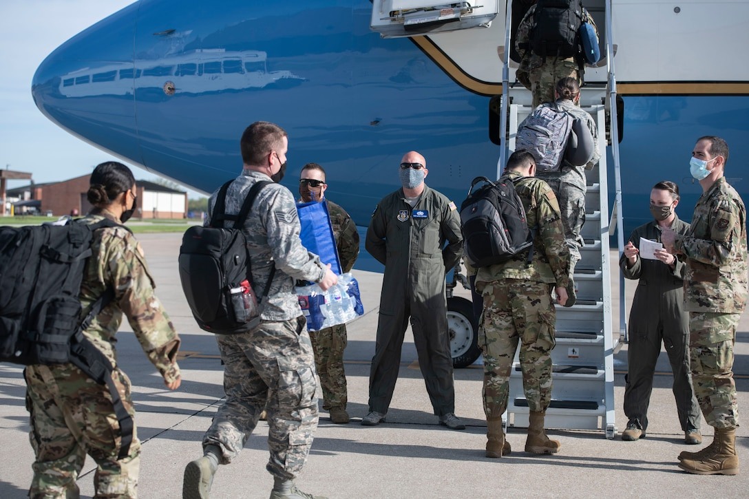 Medical personnel from the 932nd Airlift Wing deploy in support of the COVID-19 relief efforts in New York, April 22, 2020, Scott Air Force Base, Illinois . These members are nurses, medical technicians and radiologists, who volunteered to reply with less than a two day notice.  (U.S. Air Force photo by Staff Sgt. Melissa Estevez)
