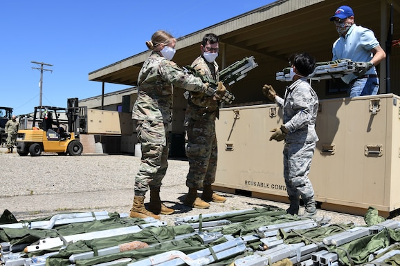 Members of the 30th Civil Engineer Squadron count cots April 22, 2020, at Vandenberg Air Force Base, Calif.