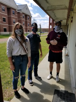 U.S. Air Force Airmen wearing homemade masks made by Langley Spouses Club members stand by dorms at Joint Base Langley-Eustis, Virginia, April 16, 2020. Along with social distancing and washing hands, wearing face masks help create another line of defense to protect from the coronavirus. (Courtesy photo)