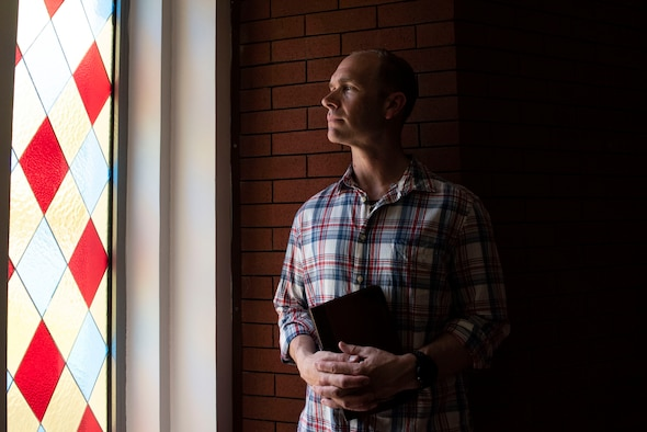 U.S. Air Force Capt. Samuel McClellan, 39th Air Base Wing chaplain, poses for a photo before conducting a worship service April 18, 2020, at Incirlik Air Base, Turkey. Amidst the COVID-19 pandemic, the chaplain encouraged people not to be overcome by fear, saying humankind has faced innumerable challenges before and survived. (U.S. Air Force photo by Staff Sgt. Joshua Magbanua)