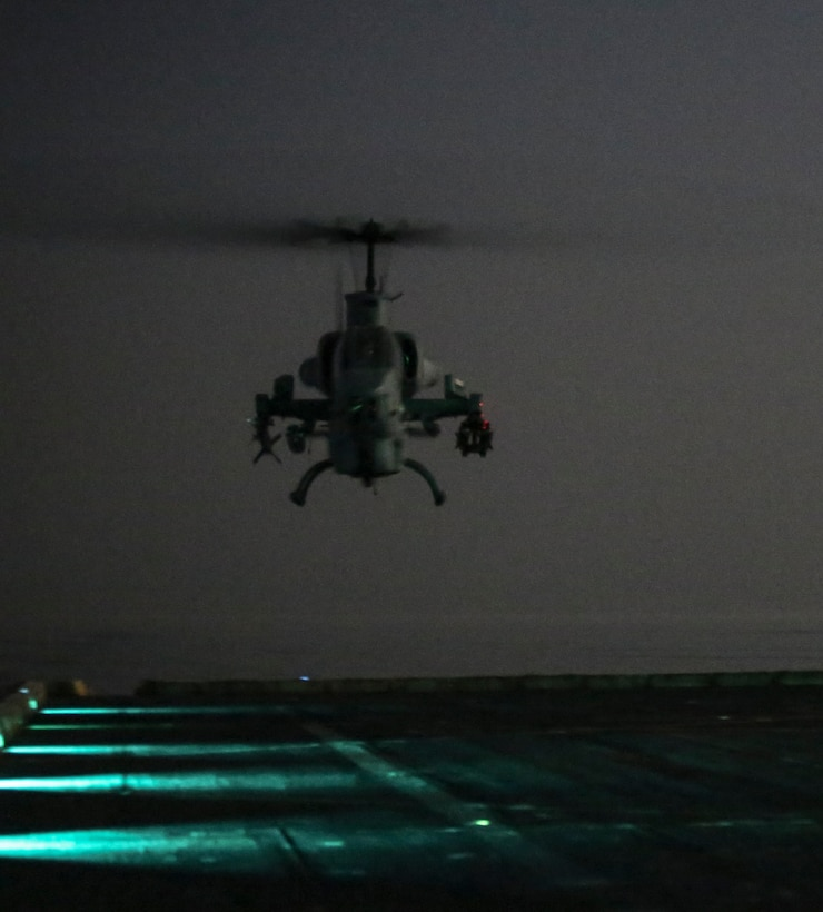 200407-M-MV109-1129 U.S. 5TH FLEET AREA OF OPERATIONS (April 7, 2020) A U.S. Marine Corps AH-1W Super Cobra assigned to Marine Medium Tiltrotor Squadron (VMM) 365 (reinforced), 26th Marine Expeditionary Unit (MEU), prepares to land on the flight deck of the amphibious transport dock USS New York (LPD 21) April 7, 2020. New York, with embarked 26th MEU, is deployed to the U.S. 5th Fleet area of operations in support of naval operations to ensure maritime stability and security in the Central Region, connecting the Mediterranean and Pacific through the Western Indian Ocean and three strategic choke points. (Marine Corps photo by Staff Sgt. Patricia A. Morris)