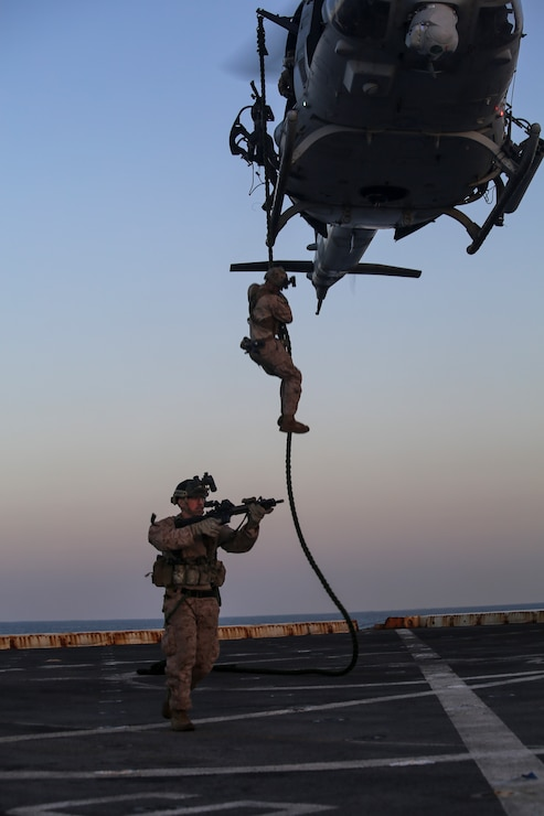 200414-M-MV109-2199 U.S. 5TH FLEET AREA OF OPERATIONS (April 14, 2020) Marines assigned to the Maritime Raid Force, 26th Marine Expeditionary Unit (MEU), fast-rope from a UH-1Y Venom aboard the amphibious transport dock USS New York (LPD 21) April 14, 2020. New York, with embarked 26th MEU, is deployed to the U.S. 5th Fleet area of operations in support of naval operations to ensure maritime stability and security in the Central Region, connecting the Mediterranean and Pacific through the Western Indian Ocean and three strategic choke points. (Marine Corps photo by Staff Sgt. Patricia A. Morris)