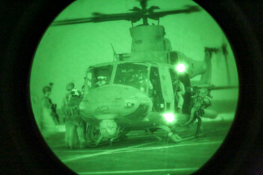 200414-M-MV109-2294 U.S. 5TH FLEET AREA OF OPERATIONS (April 14, 2020) Marines assigned to the Maritime Raid Force, 26th Marine Expeditionary Unit (MEU), load into a UH-1Y Venom above the amphibious transport dock USS New York (LPD 21) April 14, 2020. New York, with embarked 26th MEU, is deployed to the U.S. 5th Fleet area of operations in support of naval operations to ensure maritime stability and security in the Central Region, connecting the Mediterranean and Pacific through the Western Indian Ocean and three strategic choke points. (Marine Corps photo by Staff Sgt. Patricia A. Morris)