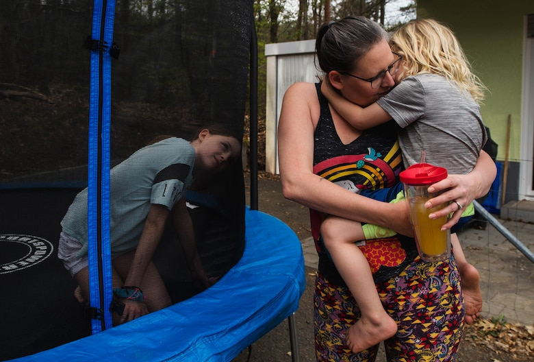 Beth, wife of U.S. Army Sgt. 1st Class Cody Camp, U.S. Army Recruiting Command senior guidance counselor center, holds her son, Jack, in their back yard in Kaiserslautern, Germany