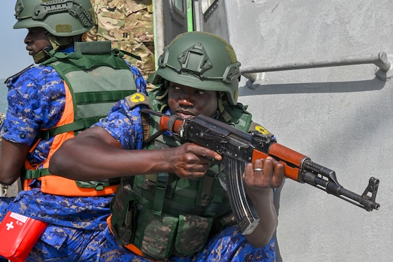 Members of the Gambia Navy boarding team provide security while conducting a simulated drug smuggling and human trafficking scenario during Exercise Obangame Express 2019 in Banjul, Gambia, March 16, 2019.