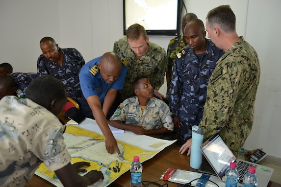 Cutlass Express 19.2 participants plot a course during a tabletop exercise in Djibouti, Djibouti, Oct. 30, 2019.