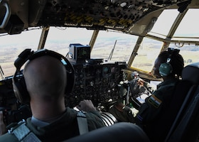 Two pilots fly a plane.