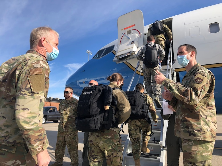 Master Sgt. Blair Bookland (left) and members of the 932nd Medical Group board an 932nd Airlift Wing C-40C, April 22 at Scott Air Force Base, Illinois to support COVID-19 relief efforts in New York. 932nd MDG commander, Col. Chris Spinelli (right) says farewell as they depart. This latest deployment brings the total of Air Force Reservists mobilized in support of COVID-19 relief efforts to more than 770 around the nation. (U.S. Air Force photo by Lt. Col. Stan Paregien)