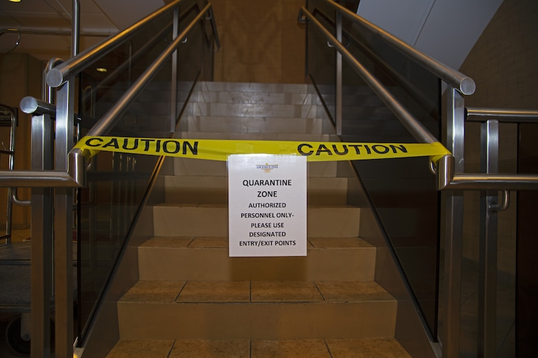 A quarantine sign and caution tape block the stairs in the Temporary Lodging Facility lobby at Joint Base Andrews, Md., April 13, 2020. The devoted TLF floor is dedicated to quarantine individuals traveling from out of state to ensure they present no symptoms.