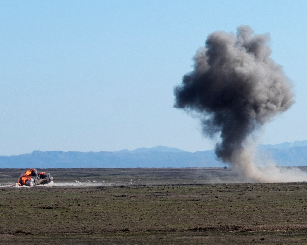 Explosions from two Mark 82 bombs ignite, April 17, 2020, at Orchard Combat Training Center, Idaho. Two F-15E Strike Eagles dropped live bombs while working directly with the Idaho Air National Guard to improve joint training capabilities. (U.S. Air Force photo by Airman Natalie Rubenak).