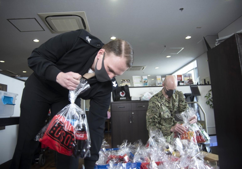 Commander, Fleet Activities Yokosuka Delivers Goodie Bags to ROM Sailors