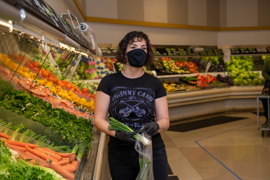 U.S. Air Force Senior Airman Nichole Krinberg, 60th Aerial Port Squadron air transportation journeyman, shops for vegetables April 16, 2020, inside the commissary at Travis Air Force Base, California. Since the coronavirus pandemic, some food and household goods such as toilet paper and paper towels have become increasingly scarce. (U.S. Air Force photo by Tech. Sgt. James Hodgman)