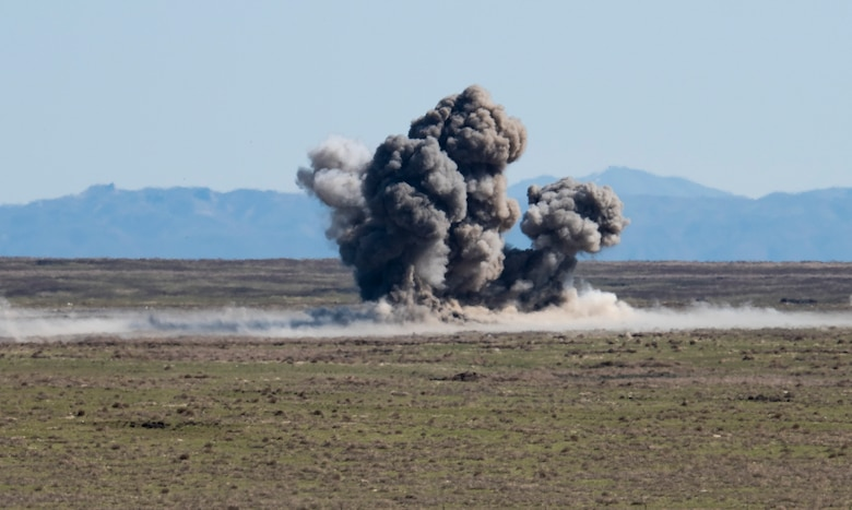 An exposion from a Mark 82 bomb ignites, April 17, 2020, at Orchard Combat Training Center, Idaho. Two F-15E Strike Eagles from the 391st Fighter Squadron dropped six Mark 82 bombs into the dudded impact area to enhance training capabilities with the Army National Guard. (U.S. Air Force photo by Airman Natalie Rubenak).