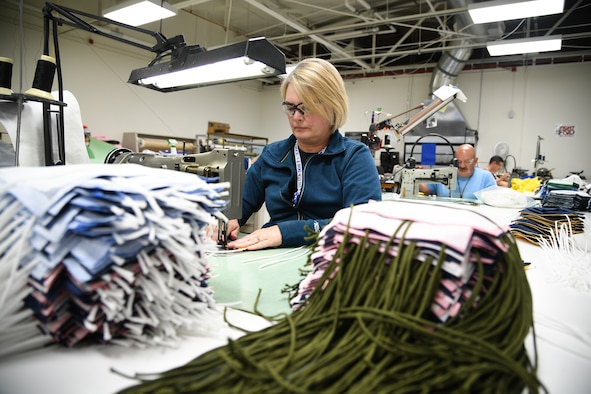 Aircrew Flight Equipment technicians with the 531st Armament Textile Shop make protective cloth masks at Hill Air Force Base, Utah, April 15, 2020. The shop is using their skill set and equipment to produce cloth face coverings for members of Team Hill. (U.S. Air Force photo by R. Nial Bradshaw)