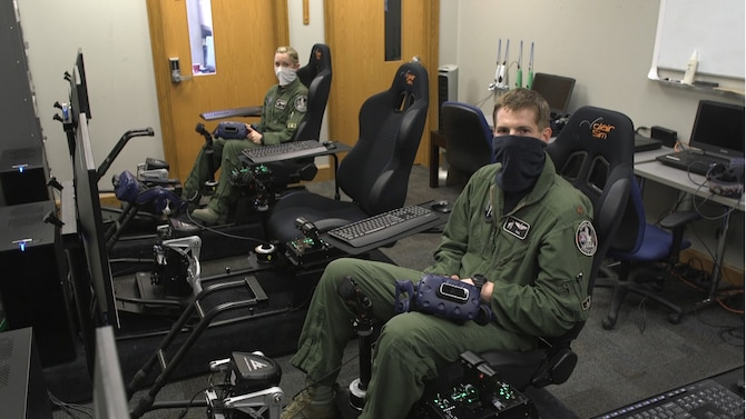 Maj. Meghan Booze and Maj. Matthew Ross, both pilots with the 4th Fighter Wing preparing to perform a Virtual Reality flyover during the iRacing NASCAR Pro Invitational hosted by the Richmond Raceway April 20, 2020.