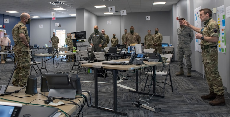 Photo of Gen. Mike Holmes, commander of Air Combat Command, receiving a brief the Task Force-Southeast Joint Operations Center