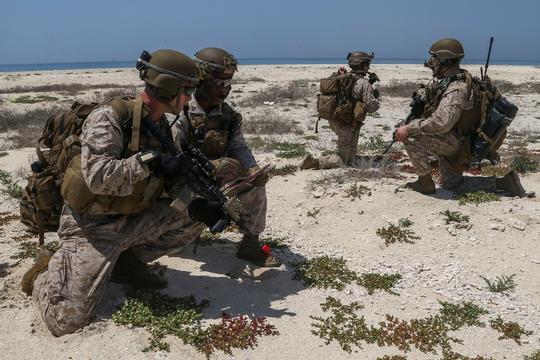 200422-M-KE756-1022 U.S. 5TH FLEET AREA OF OPERATIONS (April 22, 2020) Marines assigned to Fox Company, Battalion Landing Team 2/8, 26th Marine Expeditionary Unit (MEU), establish a defensive position during platoon-level training on Kurayn Island, Saudi Arabia, April 22, 2020. The Bataan Amphibious Ready Group and 26th MEU, supported by air power from the Aviation Combat Element of the ARG/MEU, including AV-8B Harriers and attack helicopters, are conducting routine sustainment training in the U.S. 5th Fleet area of operations in order to enhance the Navy-Marine Corps team's ability to employ low-signature, operationally relevant and strategically mobile crisis response forces to project power over key maritime terrain. (U.S. Marine Corps photo by Cpl. Tanner Seims)