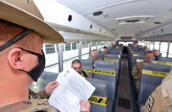 A drill sergeant checks to make sure all Soldiers have boarded the bus that will take them to Joint Base San Antonio-Fort Sam Houston