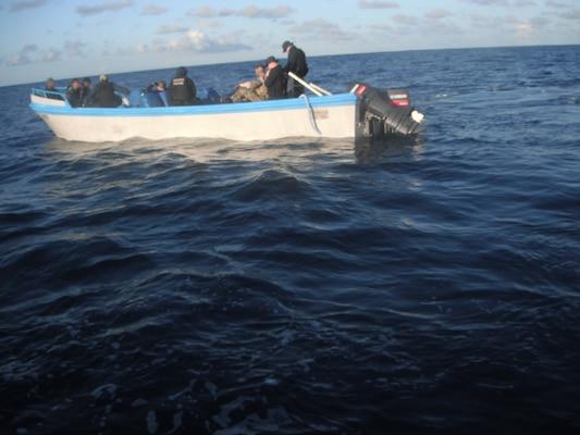 A U.S. Coast Guard boarding team searches a suspected smuggling vessel.