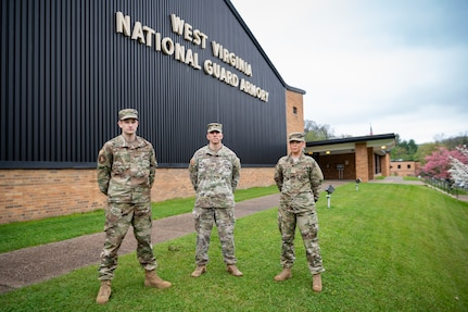 Senior Airman Will Wagstaff (left), Maj. Ryan Coss (center) and Senior Airman Carly Farmer pose for a photo outside the West Virginia National Guard Joint Forces Headquarters in Charleston, W.Va. Coss, Wagstaff and Farmer are serving as a part of Task Force Petersen, the task force dedicated to procuring and forecasting demand for critical personal protective equipment for the State of West Virginia's response to the ongoing COVID-19 pandemic. (U.S. Air National Guard photo by Staff Sgt. Caleb Vance.)