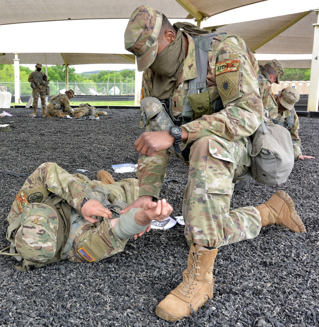 Basic Officer Leadership Course student practices providing Tactical Combat Casualty Ca