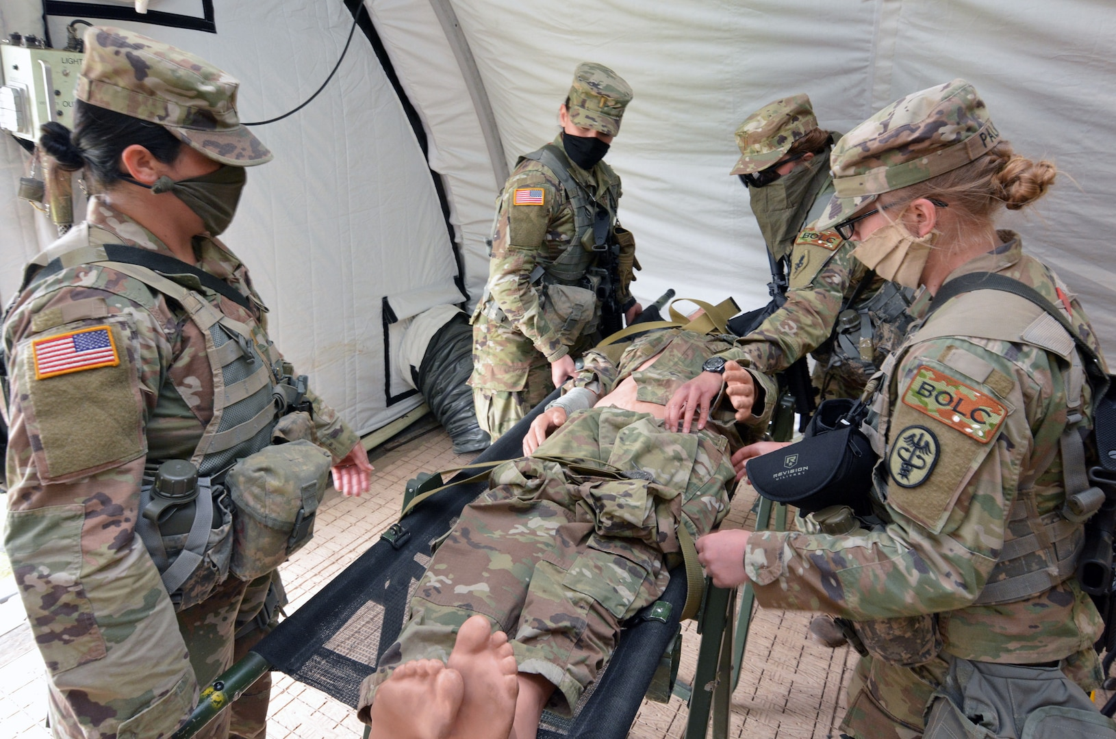 Basic Officer Leadership Course students practice moving a simulated causality into a field hospital while practicing tactical dispersion and social distance during a field training exercise at Joint Base San Antonio-Camp Bullis April 14.