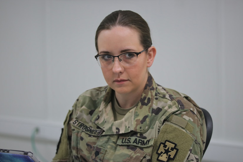Spc. Chala Strosnider, a 68S Preventative Medicine Specialist with the 480th Medical Detachment (Preventive Medicine), reviews course materials with her instructors and classmates during the emergency Basic Leader Course (eBLC) in Jordan. Due to the current Coronavirus Disease 2019 (COVID-19) pandemic, junior enlisted Soldiers are continuing their professional military education through distance learning while travel restrictions are in place.