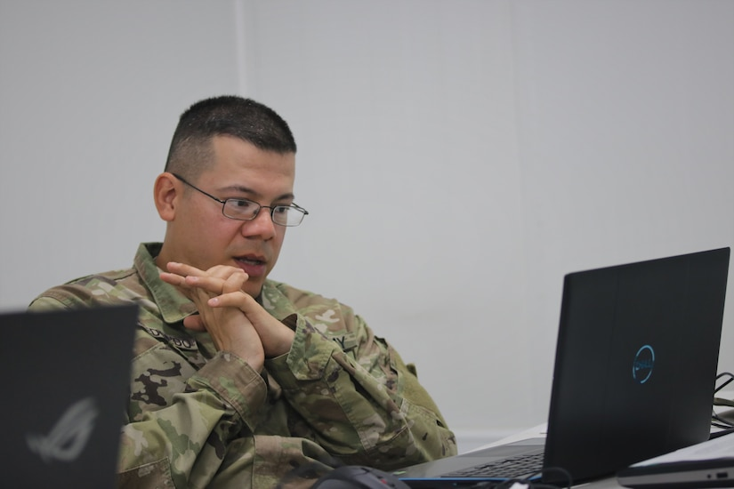 Cpl. Juan Arredondo, a 68W Health Care Specialist with the 1st Squadron, 303rd Cavalry, Washington National Guard, reviews course materials with his instructors and classmates during the emergency Basic Leader Course (eBLC) in Jordan. Due to the current Coronavirus Disease 2019 (COVID-19) pandemic, junior enlisted Soldiers are continuing their professional military education through distance learning while travel restrictions are in place.