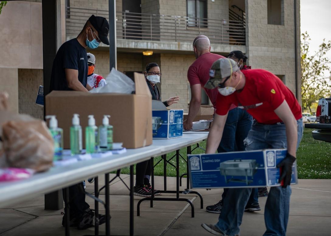 Volunteers prepare hot meals for Beale's dorm residents.