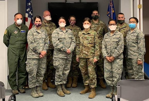 U.S. Air Force reservists from the 439th Aeromedical Staging Squadron and 439th Aerospace Medical Squadron pose for a group photo at Westover Air Reserve Base, Massachusetts on April 6, 2020. The group of doctors, nurses and medical technicians were activated to help fight against COVID-19 in New York City. (Courtesy photo)