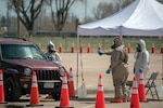 Task Force Test Support, comprised of members from the Colorado National Guard, administer COVID-19 tests at a drive-up testing site for residents of Weld County, Colorado, April 24, 2020.  Gov. Jared Polis has directed that about 70 CONG members from the Chemical, Biological, Radiological, Nuclear and high-yield Enhanced Response Force Package based at Buckley Air Force Base, Aurora, Colorado, assist with testing around the state in support of the Colorado Department of Public Health & Environment and the State Emergency Operations Center.