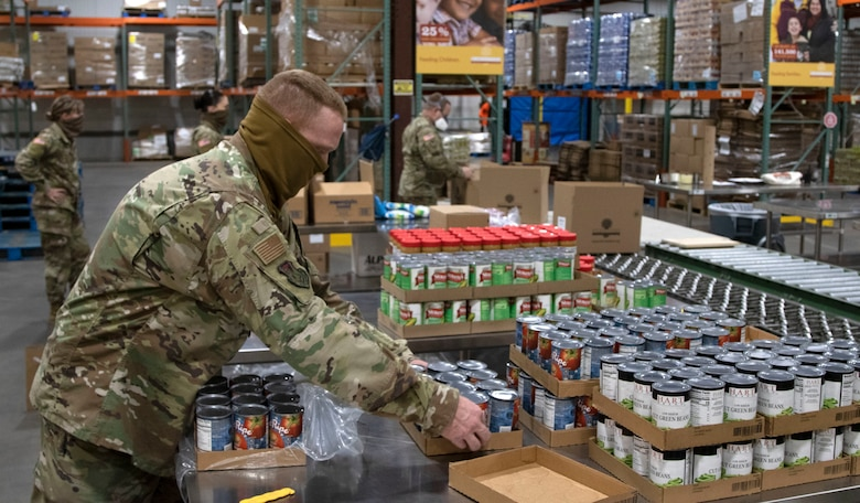 Soldiers and Airmen of the Kansas National Guard help pack food at Harvesters in Topeka, Kansas, April 22, 2020. The food will be shipped to families across the state.