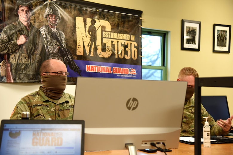 Sgt. First Class Jason Brautigam, left, and Staff Sgt. Michael Perry, recruiting and retention noncommissioned officers, Michigan Army National Guard, conduct a question-and-answer session via the internet due to social distancing restrictions caused by the COVID-19 pandemic, Dowagiac, Michigan, April 24, 2020.
