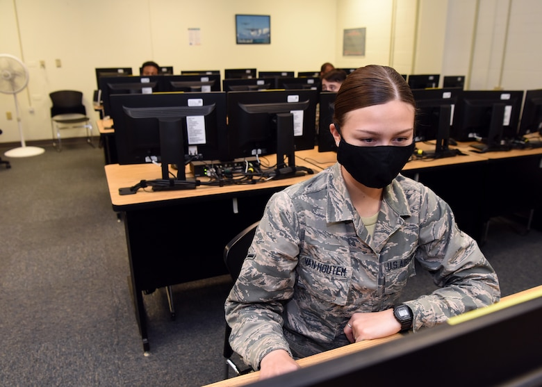 U.S. Air Force Airman Megan Van Houtem, 316th Training Squadron student, reviews her Apprentice Electronic Signals Intelligence Analyst (1N2A) course materials inside Fred Sebers Hall on Goodfellow Air Force Base, Texas, April 20, 2020. Classroom occupant capacity was downsized for the in-classroom portion section of the course to combat COVID-19. (U.S. Air Force Photo by Airman 1st Class Abbey Rieves)