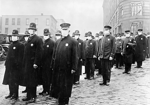 Policemen in Seattle wearing masks made by the Red Cross at the time of the Spanish flu outbreak, December 1918. (Culver Pictures via Washington State Archives)