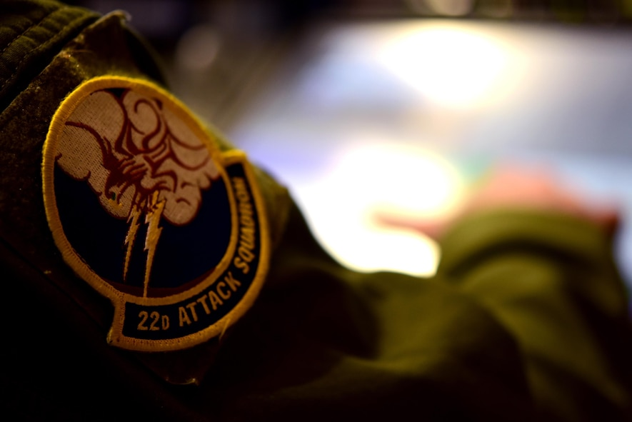 A 22nd Attack Squadron patch can be seen on the shoulder of an MQ-9 Reaper operator within a Ground Control Station at Creech Air Force Base, Nevada, April 15, 2020. The 22nd ATKS is one of several attack squadrons under the 432nd Wing/432nd Air Expeditionary Wing, a unit dedicated to 24/7 MQ-9 operations taking place around the world. (U.S. Air Force photo by Airman 1st Class William Rio Rosado)