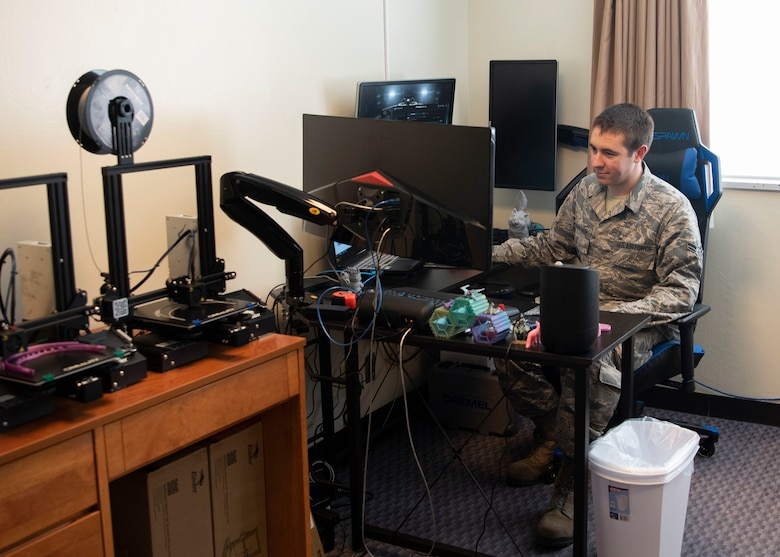 U.S. Air Force Airman 1st Class Vaughn Piwowarski-Mason, 18th Munitions Squadron munition systems specialist, prepares to print a 3D face shield through modeling software April 15, 2020, at Kadena Air Base, Japan. Piwowarski-Mason uses his personal 3D printer in his dorm room to make face shields to help protect personnel from COVID-19.