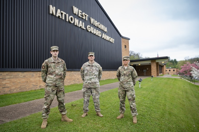 U.S. Air Force Senior Airman Will Wagstaff, left, Maj. Ryan Coss, center, and Senior Airman Carly Farmer outside the West Virginia National Guard Joint Forces Headquarters in Charleston, W.Va. Coss, Wagstaff and Farmer are serving on Task Force Petersen, which is forecasting demand for medical supplies in the state during the COVID-19 pandemic. (Photo by Staff Sgt. Caleb Vance)