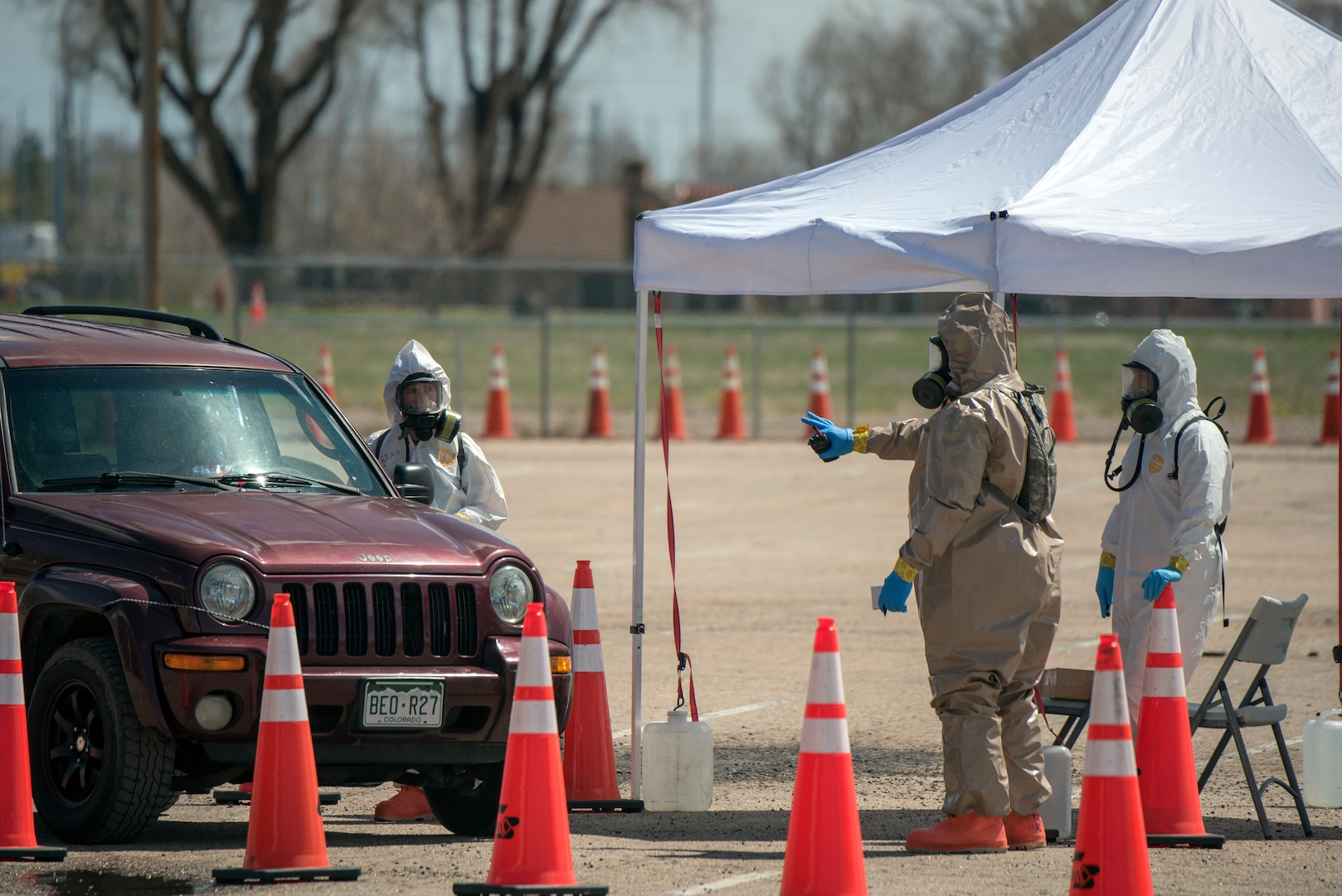 Colorado National Guard members conduct COVID-19 testing at a drive-up site in Greeley, Colorado, April 23, 2020. Nearly 70 Colorado National Guard members from the Chemical, Biological, Radiological, Nuclear and high-yield (CBRNE) Enhanced Response Force Package (CERFP) tested residents in the Greeley area.