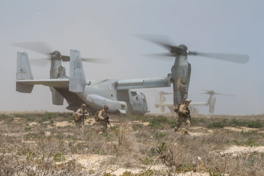 Marines assigned to Fox Company, Battalion Landing Team 2/8, 26th Marine Expeditionary Unit, exit an MV-22B Osprey to conduct platoon-level training on Kurayn Island, Saudi Arabia, April 22, 2020. The Bataan Amphibious Ready Group and 26th MEU, supported by air power from the Aviation Combat Element of the ARG/MEU, including AV-8B Harriers and attack helicopters, are conducting routine sustainment training in the U.S. 5th Fleet area of operations in order to enhance the Navy-Marine Corps team's ability to employ low-signature, operationally relevant and strategically mobile crisis response forces to project power over key maritime terrain. (U.S. Marine Corps photo by Cpl. Tanner Seims)