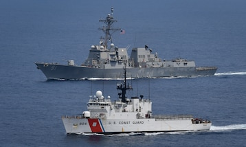 U.S. Coast Guard Cutter Northland and USS Pinckney at sea together.