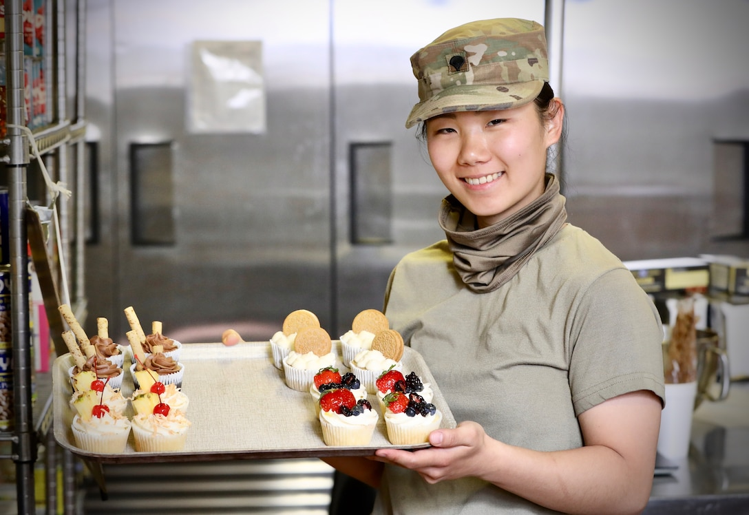 Army Reserve Soldier uses civilian skills to bring smiles to mobilized Soldiers