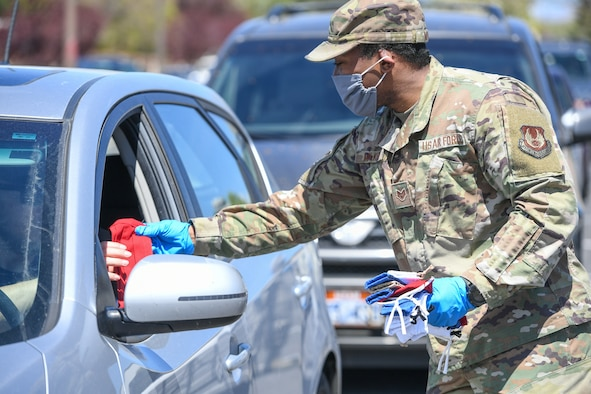 Staff. Sgt. Nicklas Mulkey, 75th Air Base Wing, hands out masks to military and civilian Airmen April 28, 2020, at Hill Air Force Base, Utah. Around 4,000 masks, most donated from nearby communities and also from the 531st Armament Textile Shop, were given out to Team Hill to keep safe and healthy during the COVID-19 pandemic. (U.S. Air Force photo by Cynthia Griggs)