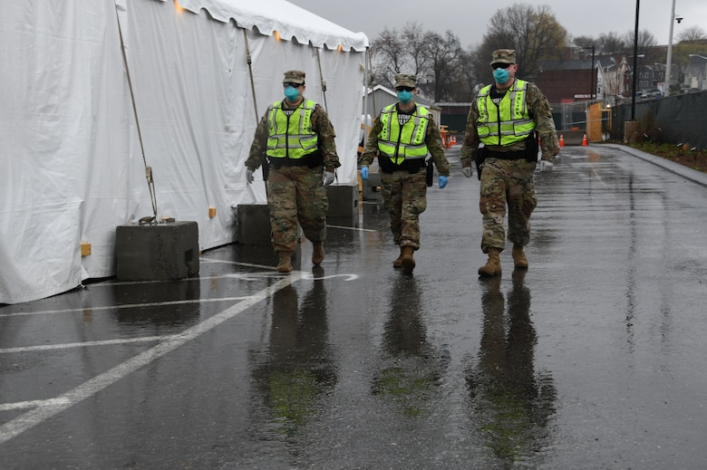 Security Forces and Military Police from the Massachusetts National Guard patrol a COVID-19 testing site for the homeless to protect supplies, patients and medical staff, Springfield, Massachusetts, April 21, 2020. Security Forces Airmen of the 104th Fighter Wing and Military Police Soldiers of the 211th Military Police Battalion, 747th Military Police Company, are working jointly as a quick reaction force in response to COVID-19.