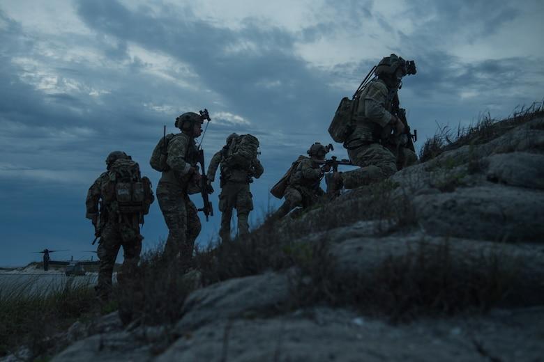 operators hike up a mountain
