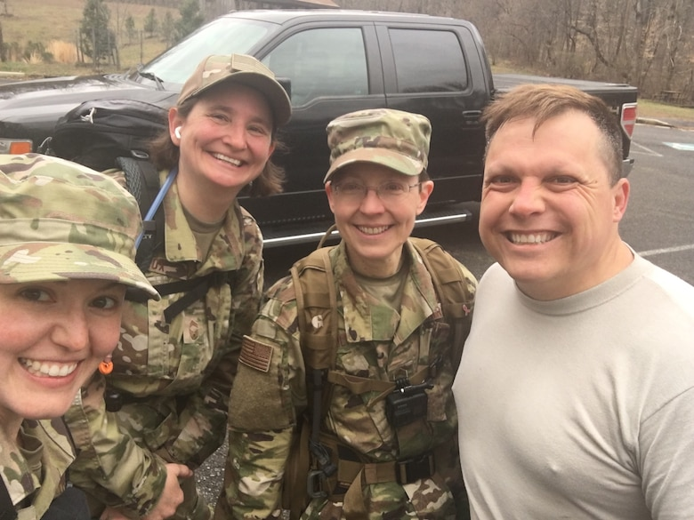 Left to right: TSgt Jilian McGreen, CMSgt Jennifer Cox, CMSgt Deborah Volker, MSgt Ruan Britts Members of the first Bataan Memorial Death March team from the USAF Band on 15 March 2020. Upon the event's cancelation, the group completed a 26.2 mile march locally.
