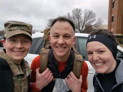 CMSgt Deborah Volker, SMSgt Bradley Bennet, and TSgt Jilian McGreen outside the USAF Band squadron having completed a training ruck on Joint Base Anacostia-Bolling