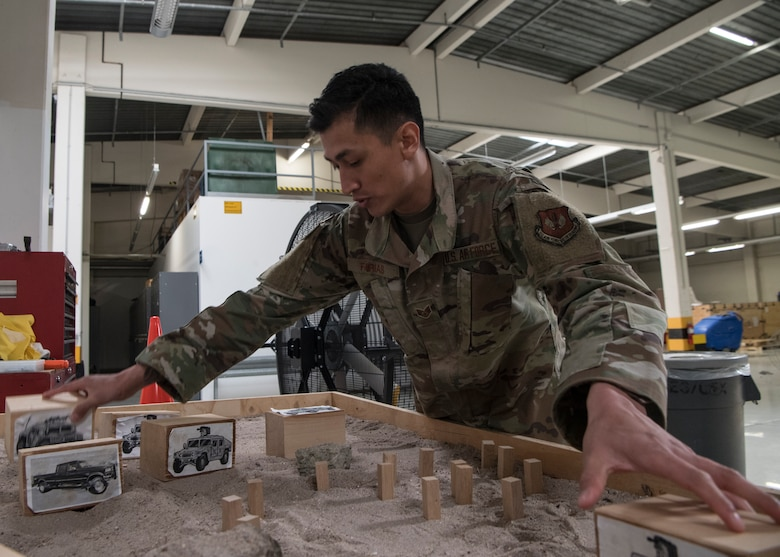 U.S. Air Force Staff Sgt. Abraham Farias, 786th Civil Engineer Squadron expeditionary engineering training manager, explains proper convoy procedures at Ramstein Air Base, Germany, April 23, 2020.
