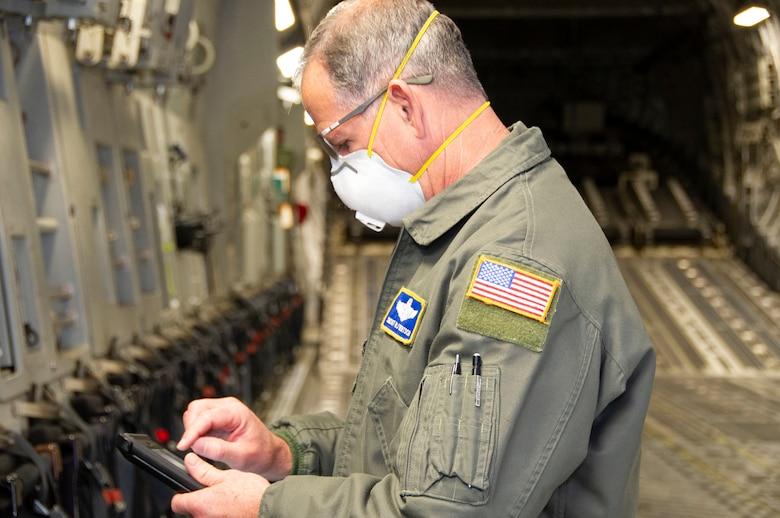 Aircrew reviews checklists on ipad on aircraft