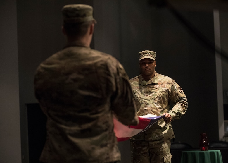 U.S. Air Force Tech. Sgt. Graeme Clouden, 786th Civil Engineer Squadron expeditionary engineering training manager, and Staff Sgt. Joseph Fabiano,435th Construction and Training Squadron engineering contingency instructor, perform a flag folding ceremony for Retired Maj. Ralph L. Turner, Tuskegee Airman, at Ramstein Air Base, Germany, April 24, 2020.